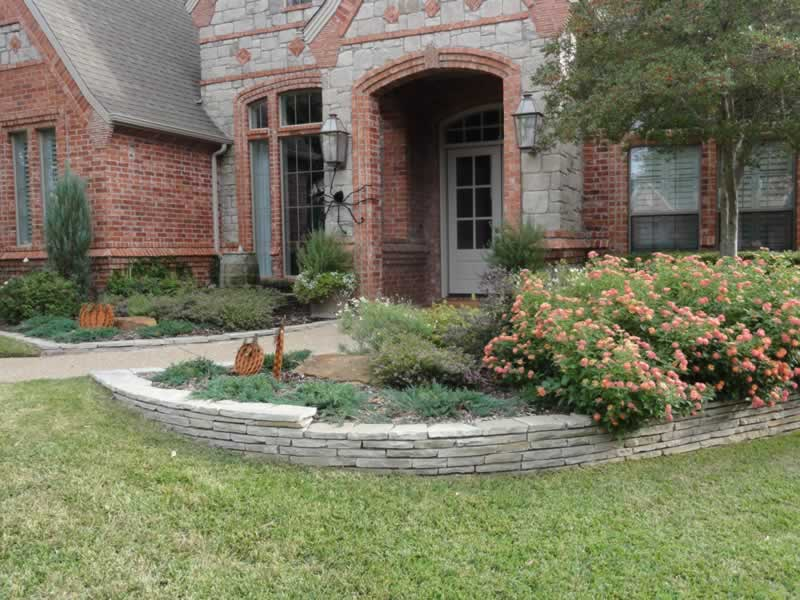 Landscaping adds beauty to the entrance of a Southlake home