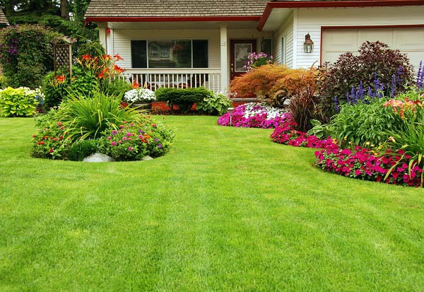 Manicured lawn with colorful freshly planted flowerbeds.