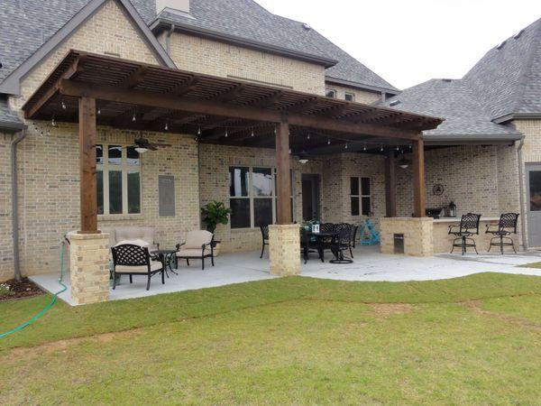 Backyard with an arbor and outdoor kitchen