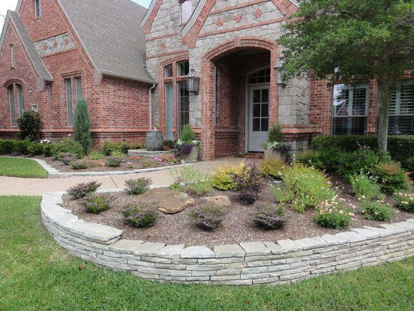 Residential front yard with newly landscaped flower beds
