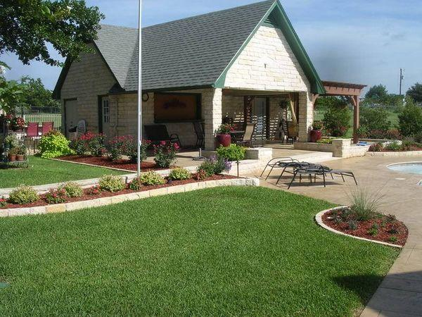 Residential guest house with new landscape and freshly mowed yard.