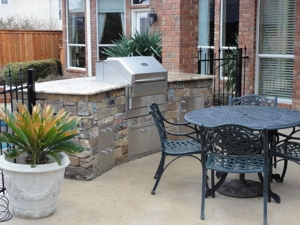 Renovated backyard with a new outdoor kitchen and patio furniture