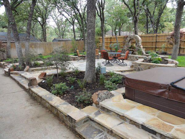 Backyard with retaining walls, patio furntiure, and upgraded landscaping